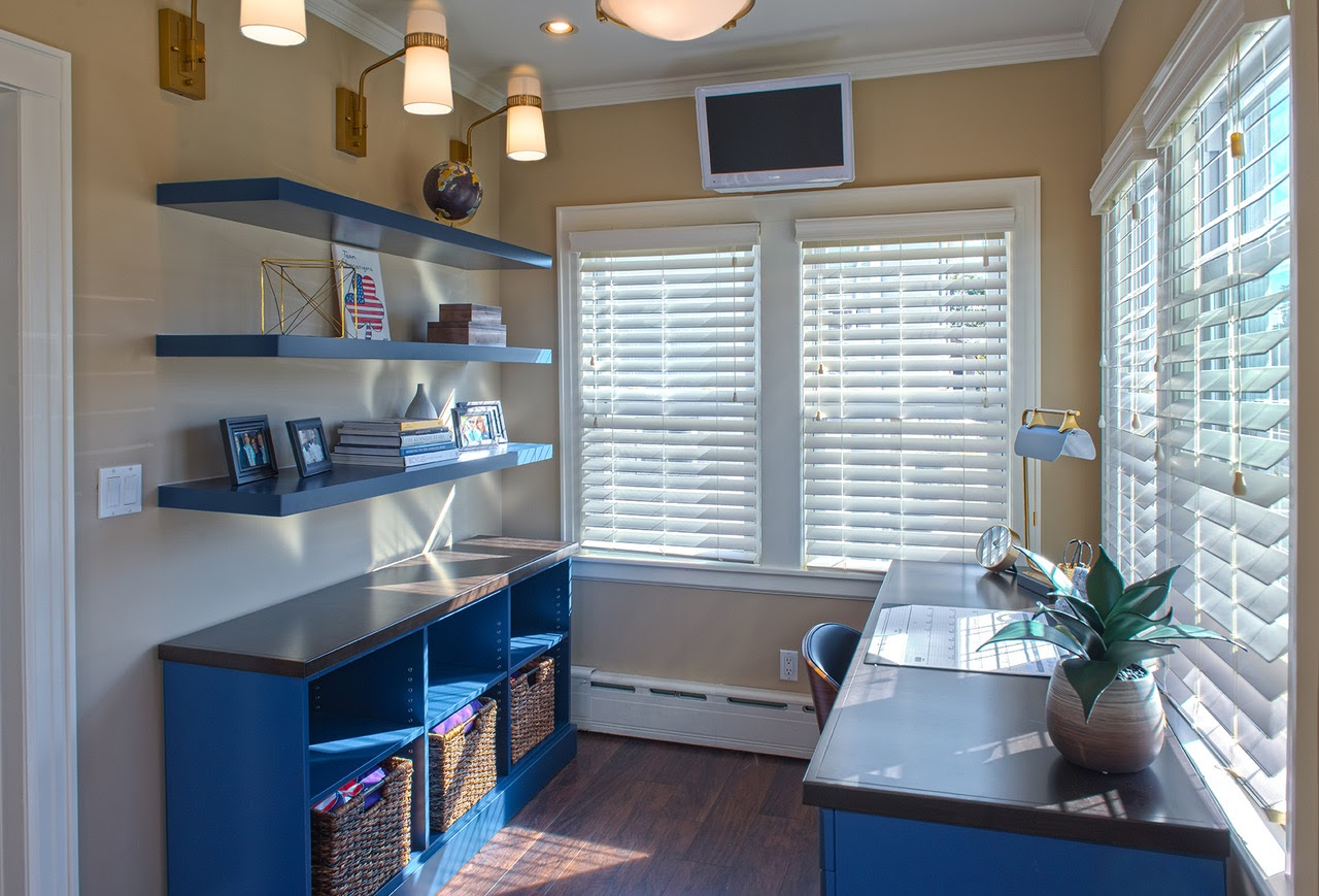 Home office with sconces and natural light