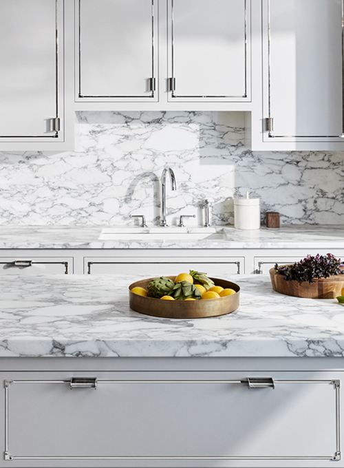 Metal details on kitchen drawers and cabinets with waterworks white marble countertops