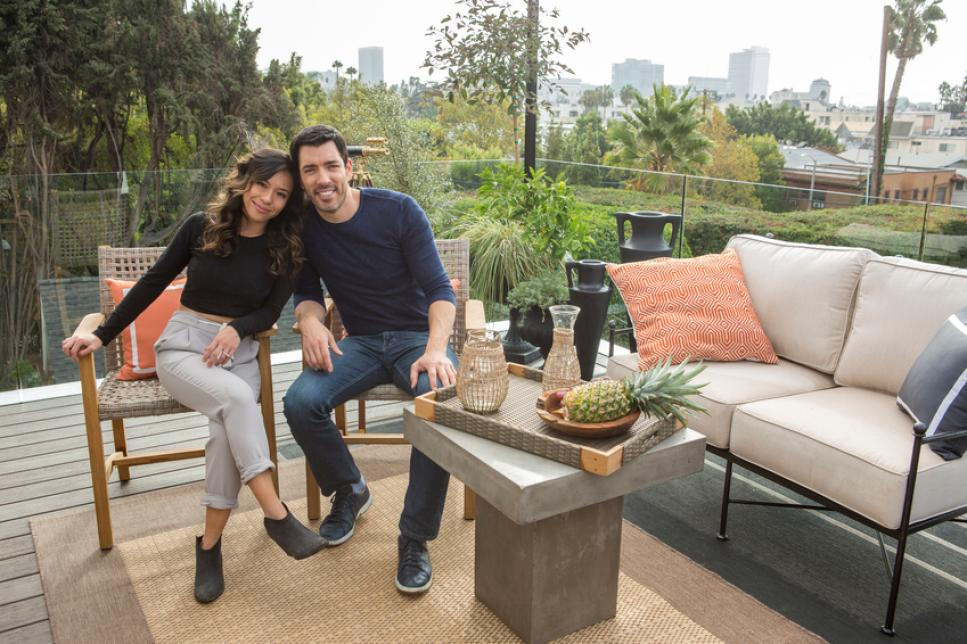 Linda Phan and Drew Scott sitting in their new Los Angeles backyard