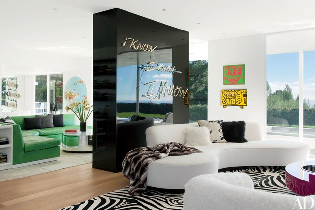 elton john los angeles living room with white couch and zebra rug